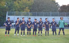 From left to right: Ivan Delgado Cruz (12), Ahmed Amine (12), Brady Gomez (12), Alex Jara (12), Alex Ortiz (12), Christian Riera (12), Johnny Llivisaca (12), Diego Giles (10) and Jose Jacinto Bastarrachea (12) line up on the field.