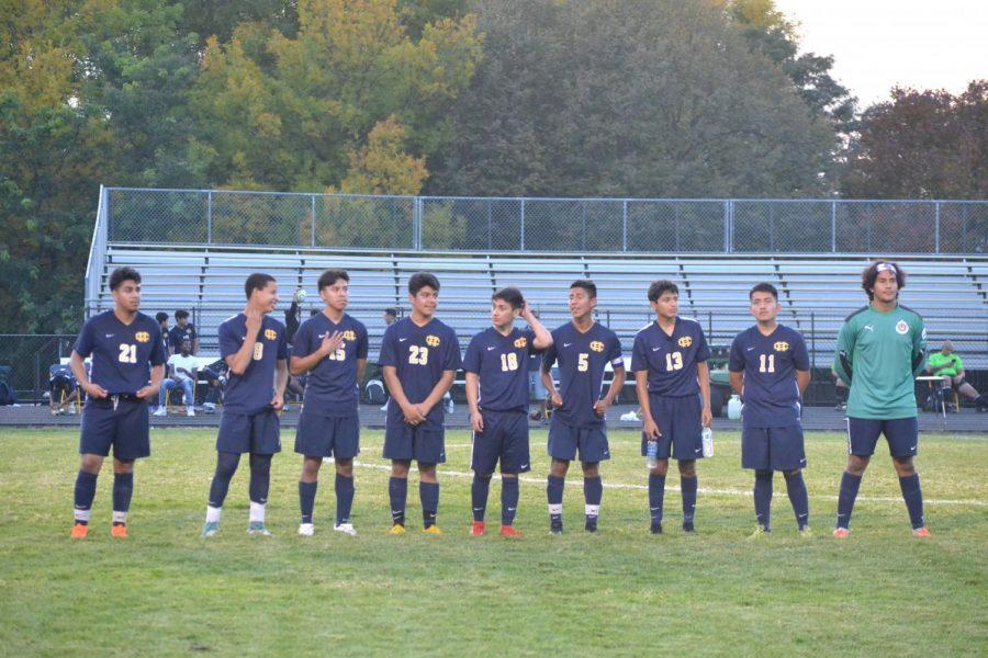 From left to right: Ivan Delgado Cruz (12), Ahmed Amine (12), Brady Gomez (12), Alex Jara (12), Alex Ortiz (12), Christian Riera (12), Johnny Llivisaca (12), Diego Giles (10) and Jose Jacinto Bastarrachea (12) line up on the field.