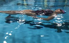 Synchronized swimming is one of the many sports that are returning to Columbia Heights High School after the season was canceled last year; here, Marissa Foy (10) gets used to the water at the CHHS pool.
