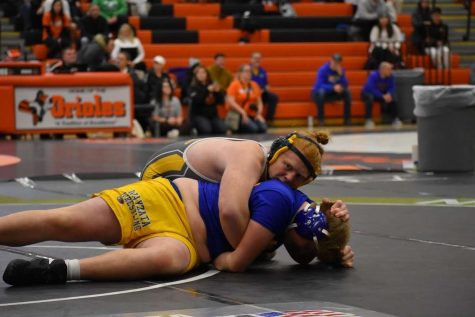 Willie Katchmark (11) pins an opponent in a sections tournament.