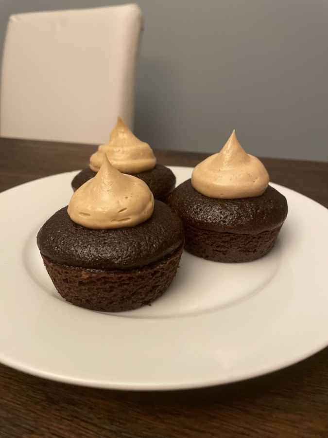 There's nothing quite like the morsel of sweetness that is the almighty cupcake. This recipe provides two delicious possible frostings: silky chocolate or peanut butter (pictured).