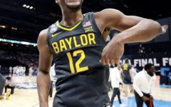Baylor University point guard, Jared Butler, celebrates after winning the NCAA basketball championship.