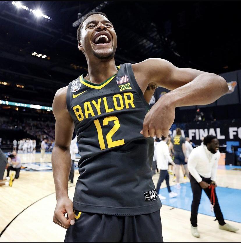 Baylor+University+point+guard%2C+Jared+Butler%2C+celebrates+after+winning+the+NCAA+basketball+championship.